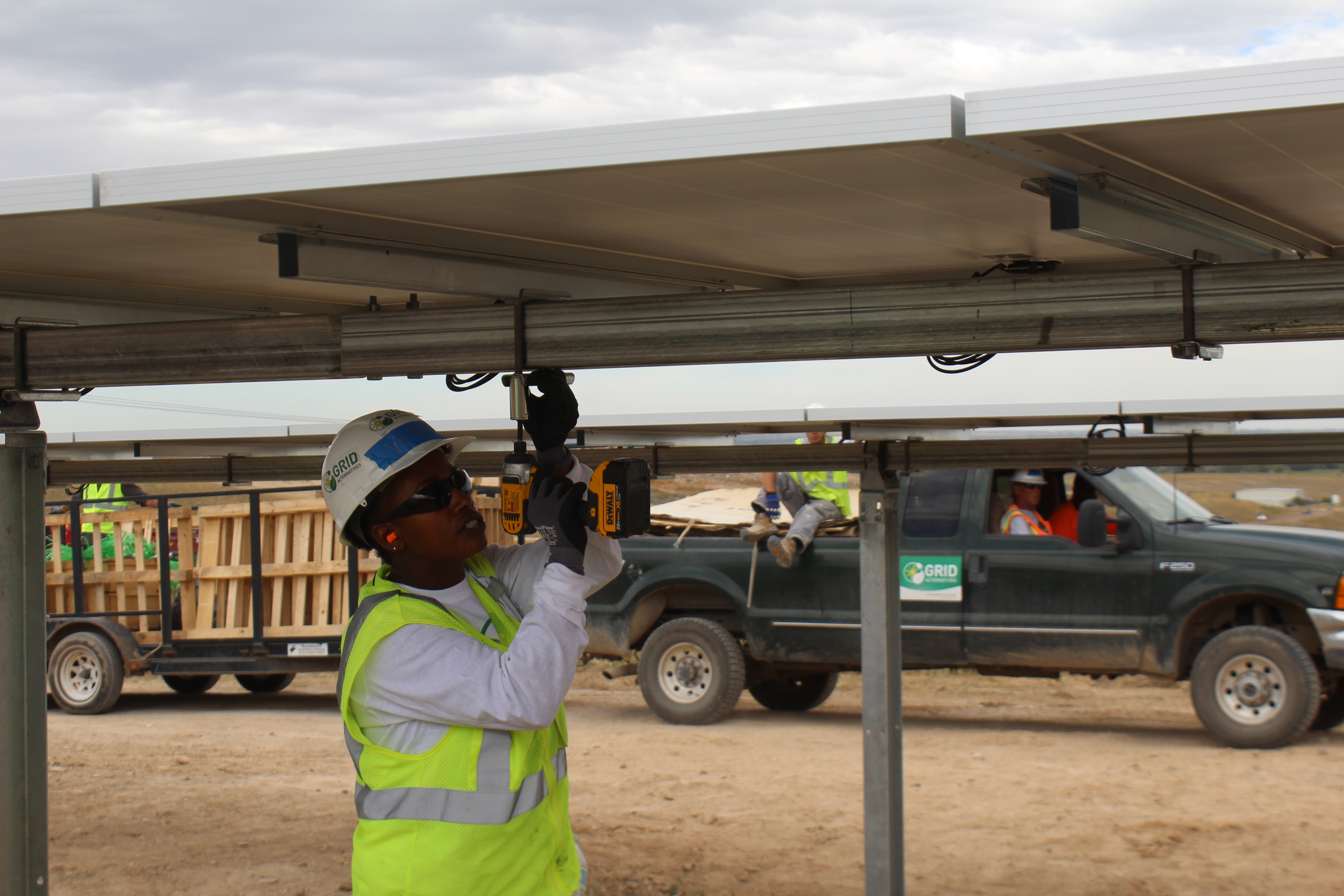 Veronica secures solar panels on GRID's 2 megawatt community solar project in Fort Collins