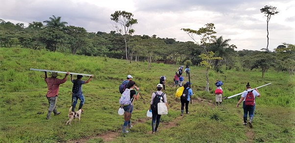 Participants carry supplies to the project site.