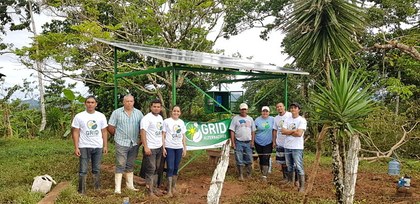 The GRID banner held at the completed project site by Nicaraguan participants