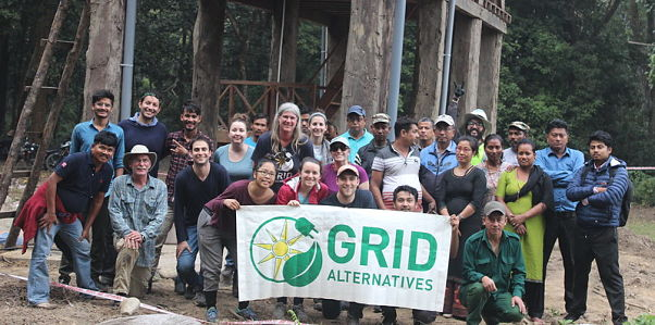 GRID participants with community members after the install