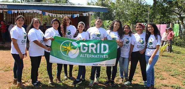 Women in Solar participants hold the GRID banner