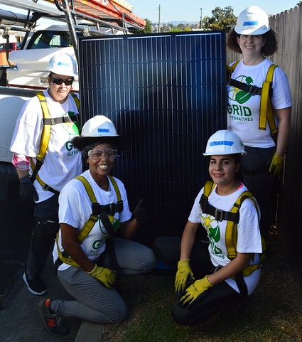 IMG: Four Women in Solar participants with a solar panel