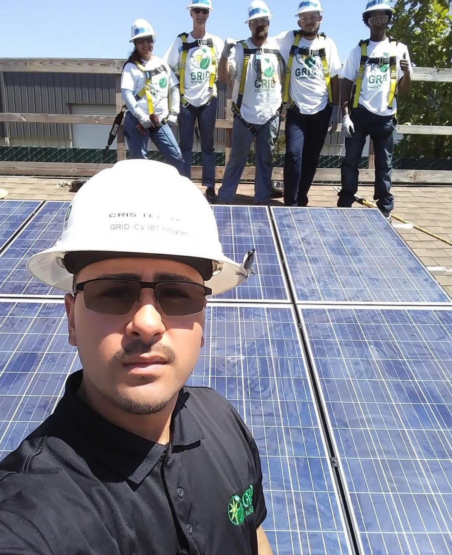 Cristian Tello on solar installation with volunteers