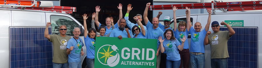 Photo of entire GRID staff with their hands in the air looking jubliant