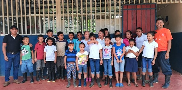 Children stand in front of their school in San Jose el Paraiso