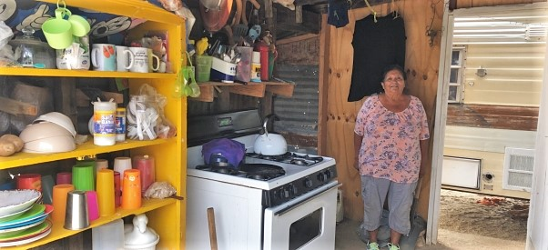 A Pai Pai woman stands in her kitchen