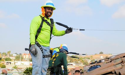 Picture of Jarell Stewart installing solar on a roof in San Diego.