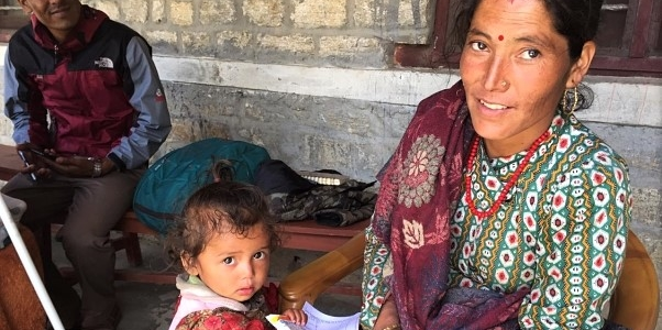 Nepali mother and child at a health Post