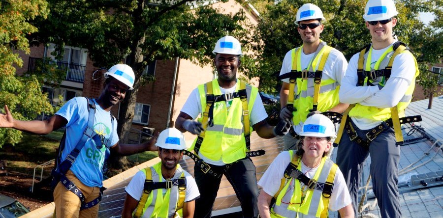 Volunteers install solar on Crest apartments