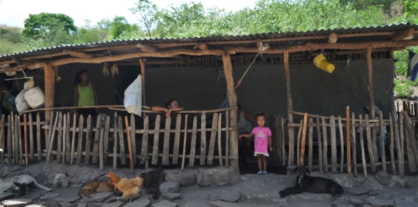 A girl stands in front of her house in Totumblita