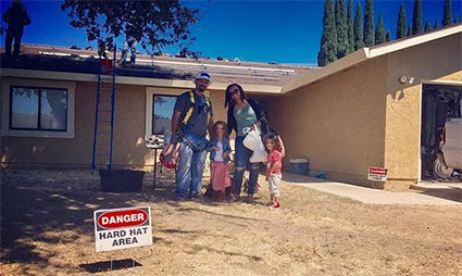 Homeowner Jesse Cortez and family
